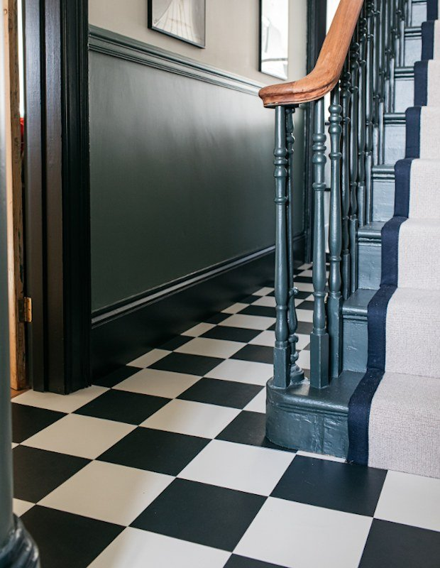 stove black and linen white hallway tiles with green colour drenched walls
