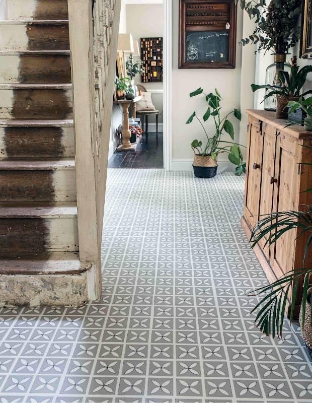 decorative lattice hallway floor tiles with summer plants and cream walls