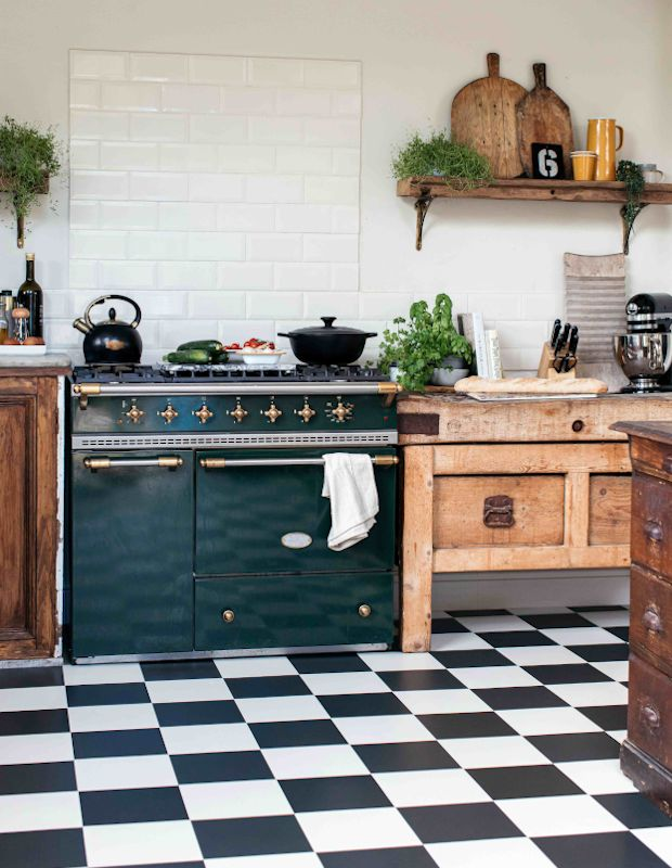 rustic kitchen with monchrome chequered flooring