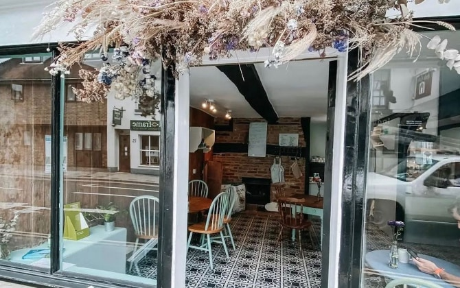 bakery with dried flowers and decorative floor tiles